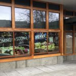 Agave Cocina and Tequilas west Seattle location with graphics of food on windows